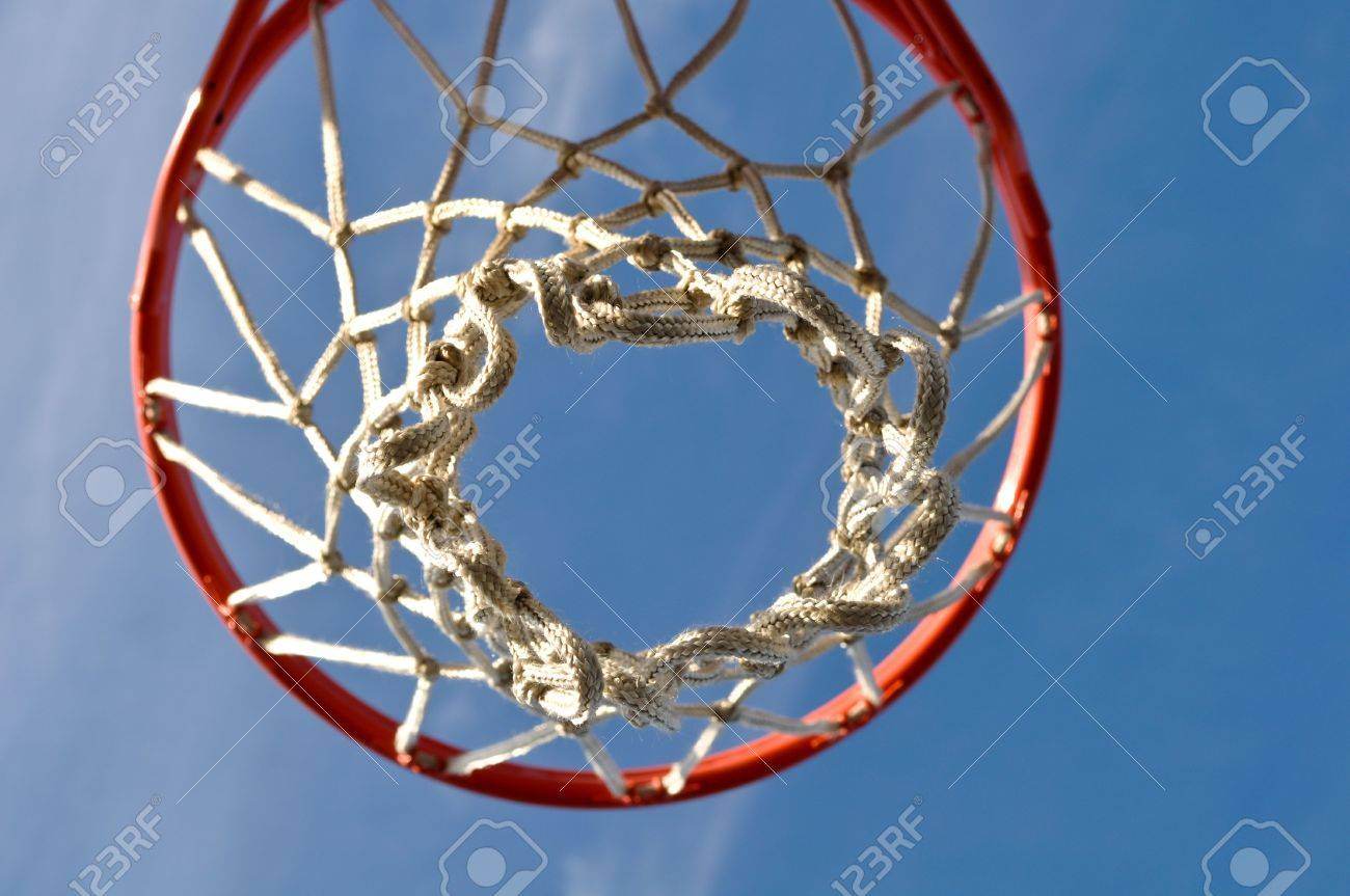 outdoor basketball hoop close up with clouds and blue sky stock