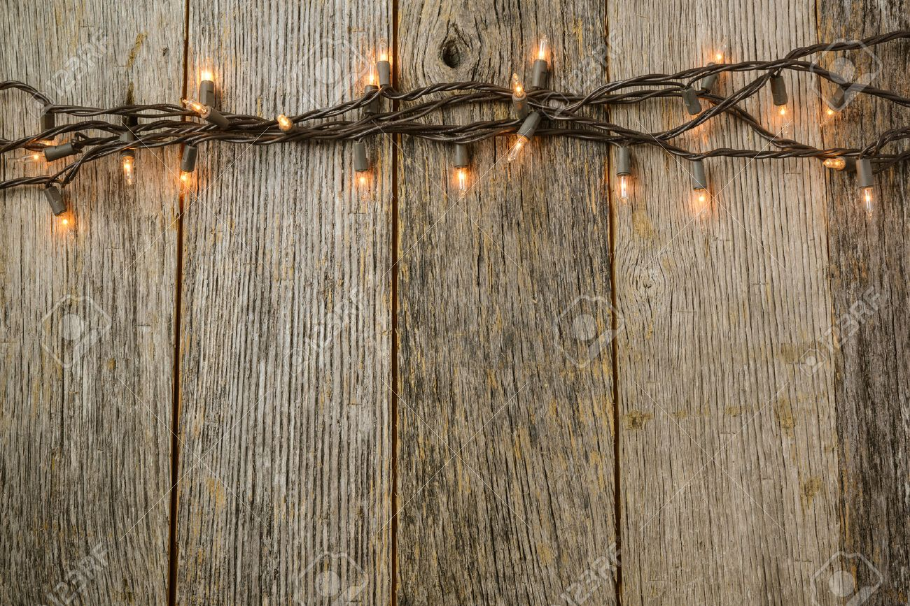 Whiite Christmas Tree Lights With Rustic Wood Background Stock Photo