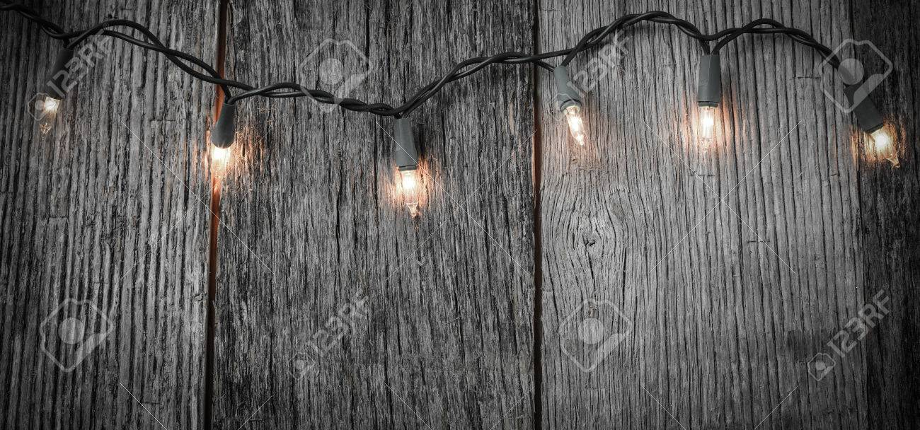 White christmas tree lights with rustic wood background stock photo stock photo white christmas tree lights with rustic wood background arubaitofo Choice Image