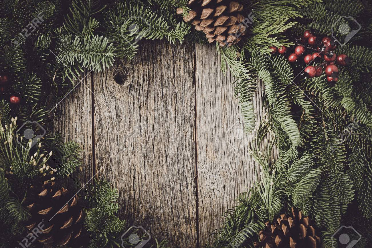 Christmas Wreath With Rustic Wood Background Stock Photo