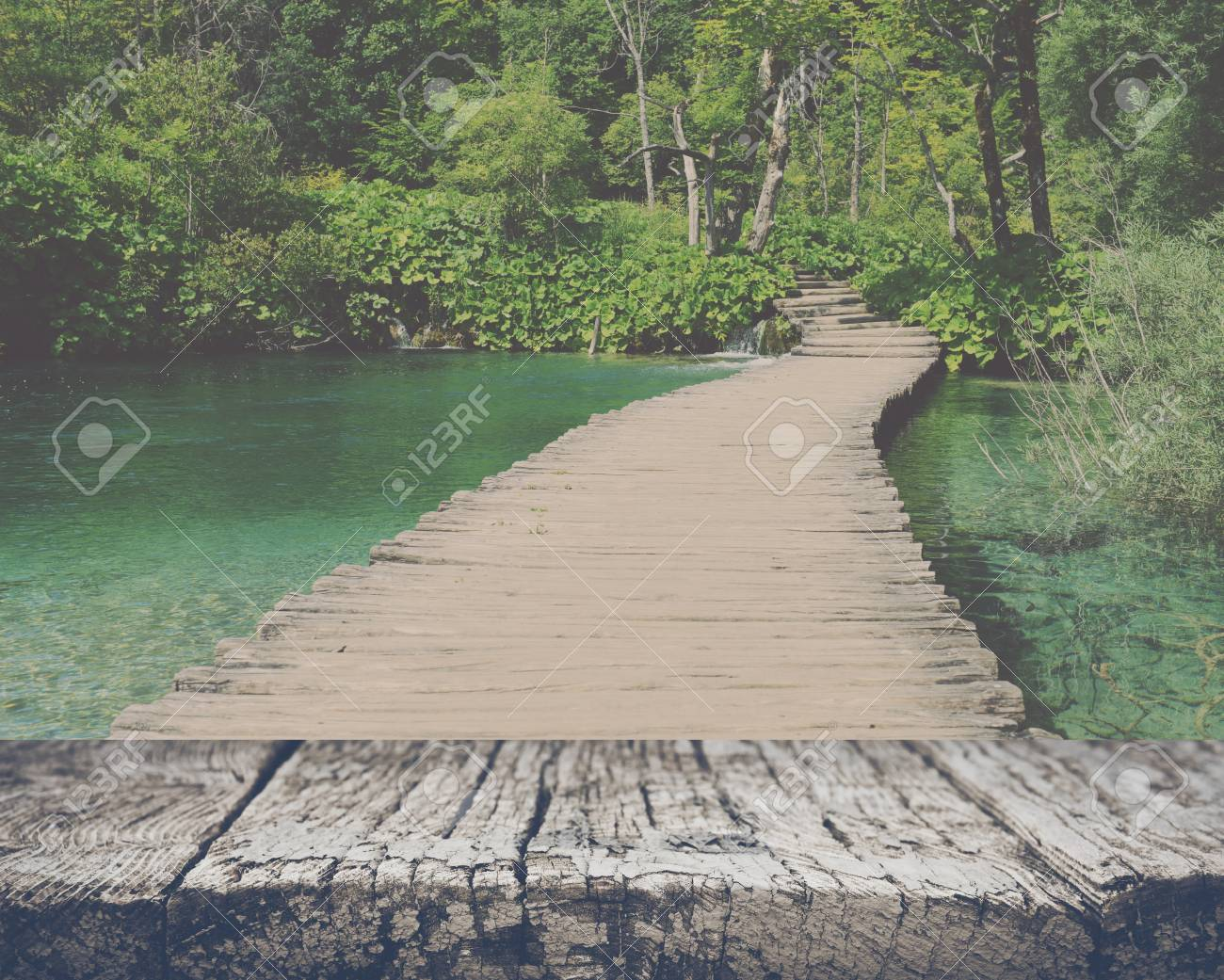 Wooden Bridge over a Pond in Plitvice National Park with retro style filter - 55007609