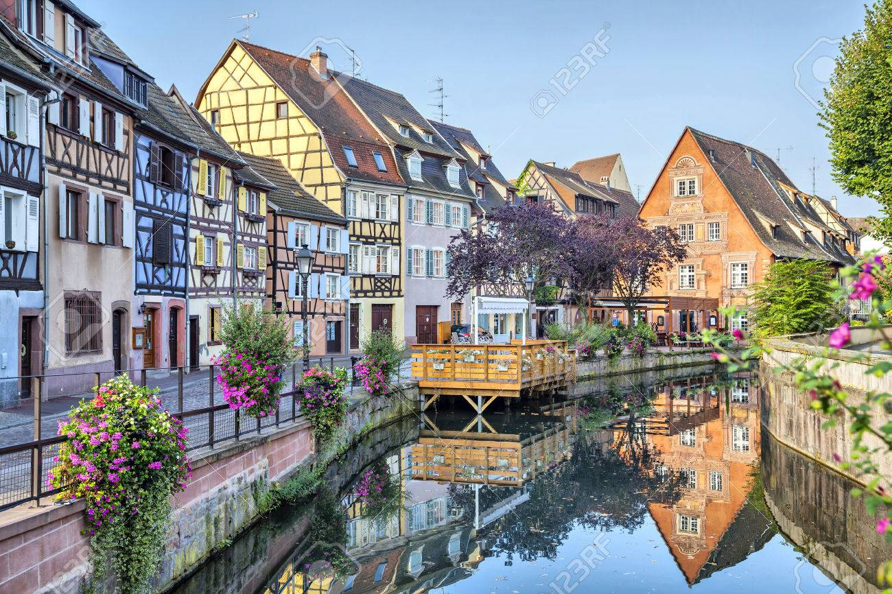 Colorful Traditional French Houses On The Side Of River Lauch In Petite Venise Colmar