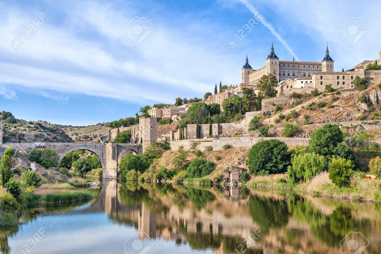 View on Puente de Alcantara and Alcazar de Toledo from side of Tagus river, Toledo, Spain - 48398880