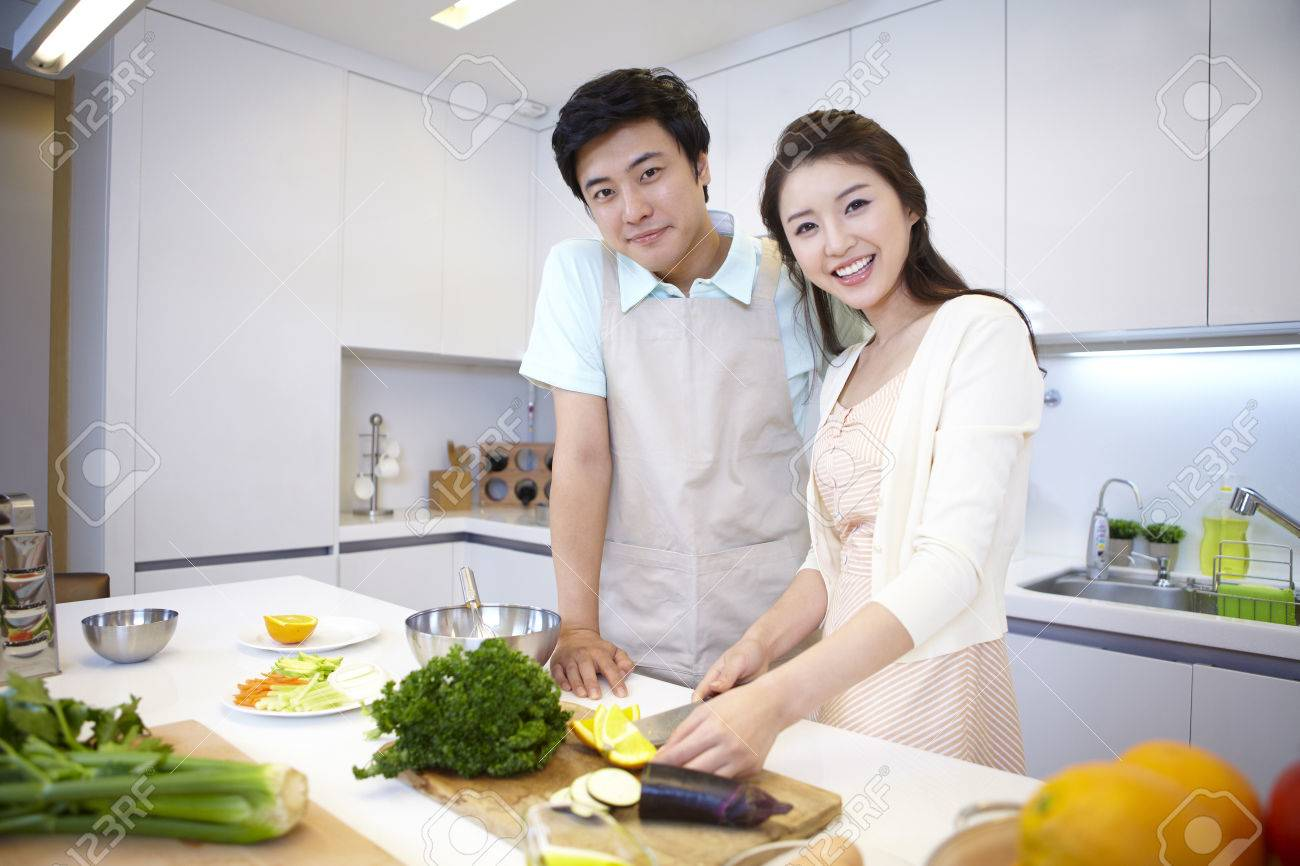 Father And Mother Cooking In The Kitchen Stock Photo, Picture And ...