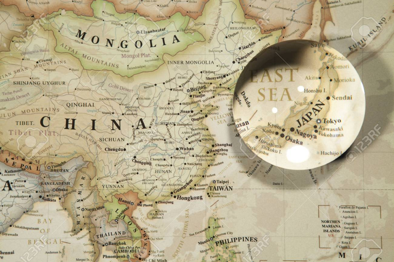 Glass ball placed on a world map stock photo picture and royalty glass ball placed on a world map stock photo 69853353 gumiabroncs Images