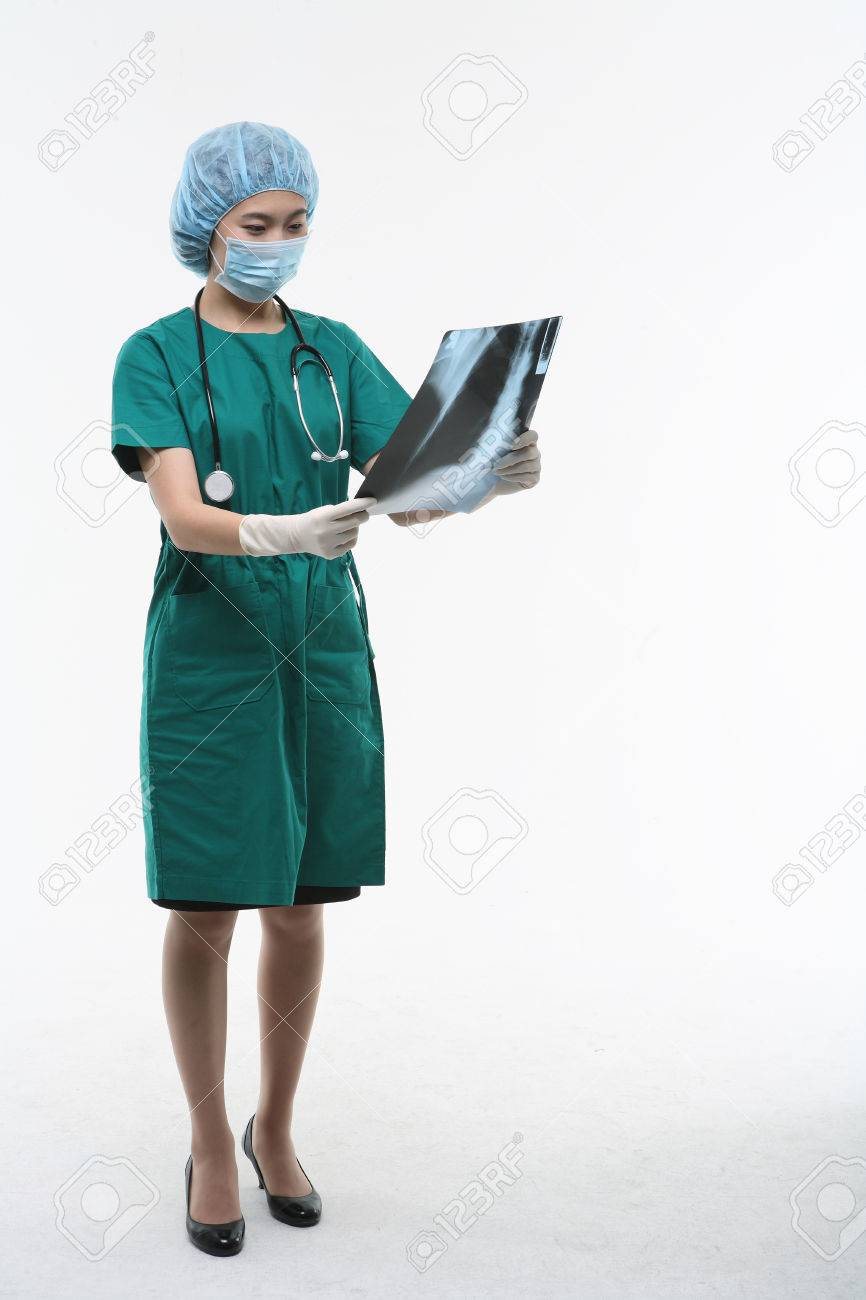 Full Shot Of A Female Surgeon Holding An X-ray Photograph As.. Stock ...