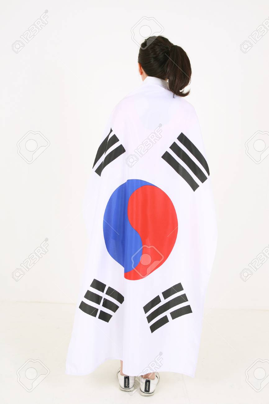 Back shot of a female korean with ponytail hair covering herself back shot of a female korean with ponytail hair covering herself with the national flag of biocorpaavc Images