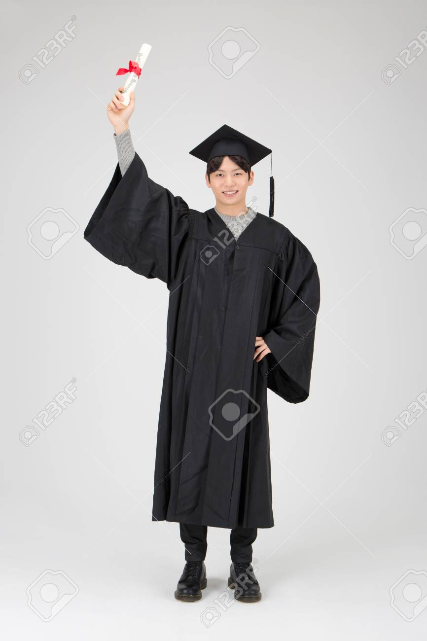 Isolated Shot Of Asian Boy In Graduation Gown With Degree Paper ...