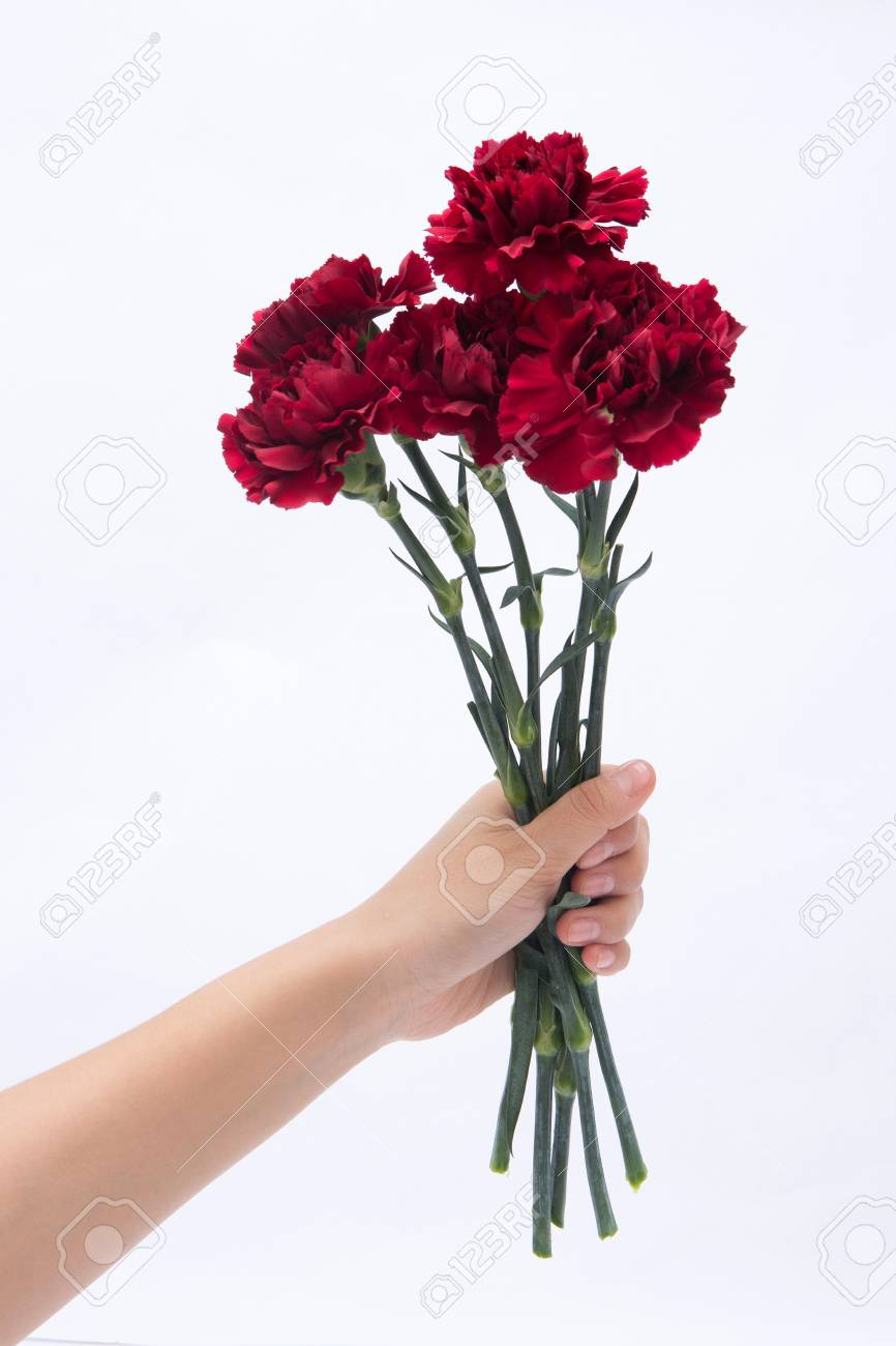 isolated shot of hands holding a small bouquet of flowers stock rh 123rf com small bunch of flowers or a sentiment or motto small bunch of flowers tattoo