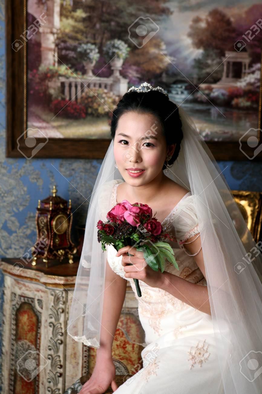 Close Up Shot Of Asian Bride In Wedding Dresses Posing In A Studio ...