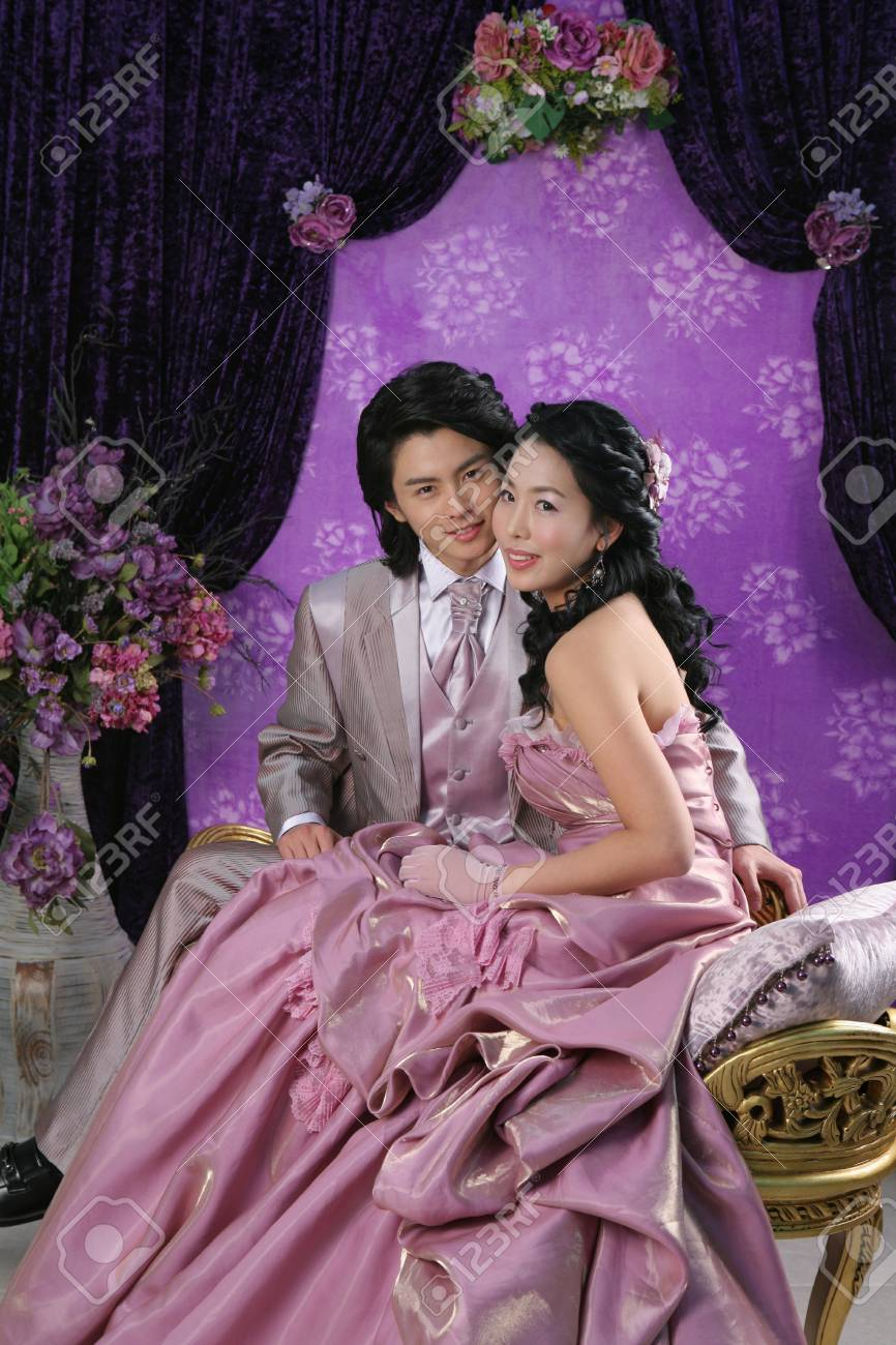 Asian Bride And Groom In Wedding Dresses Posing In A Purple Tone ...
