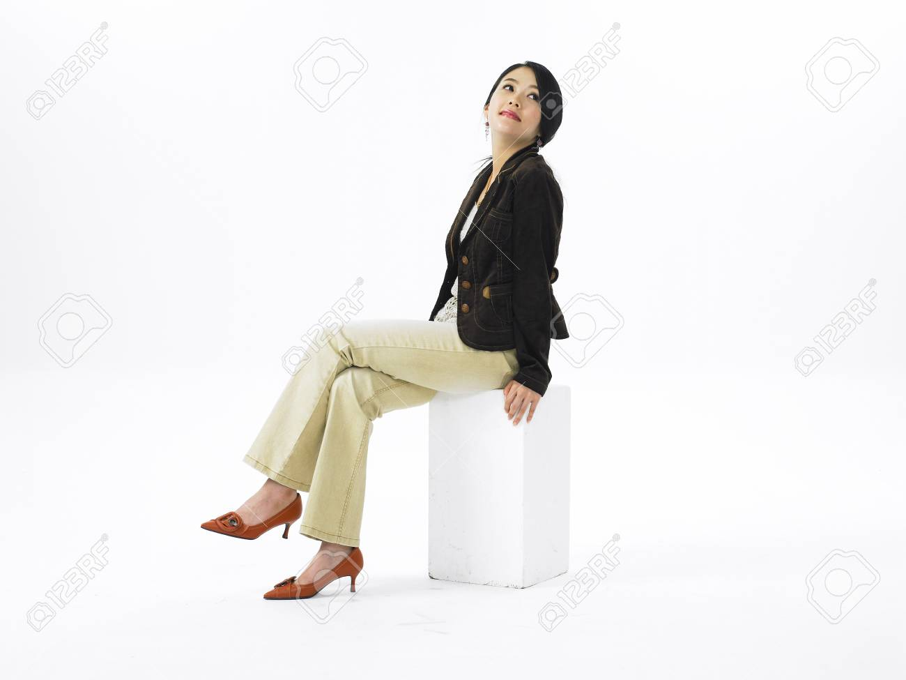f82ac975c93 Asian woman fashion model posing in a studio as wearing business casual  pants outfit Stock Photo