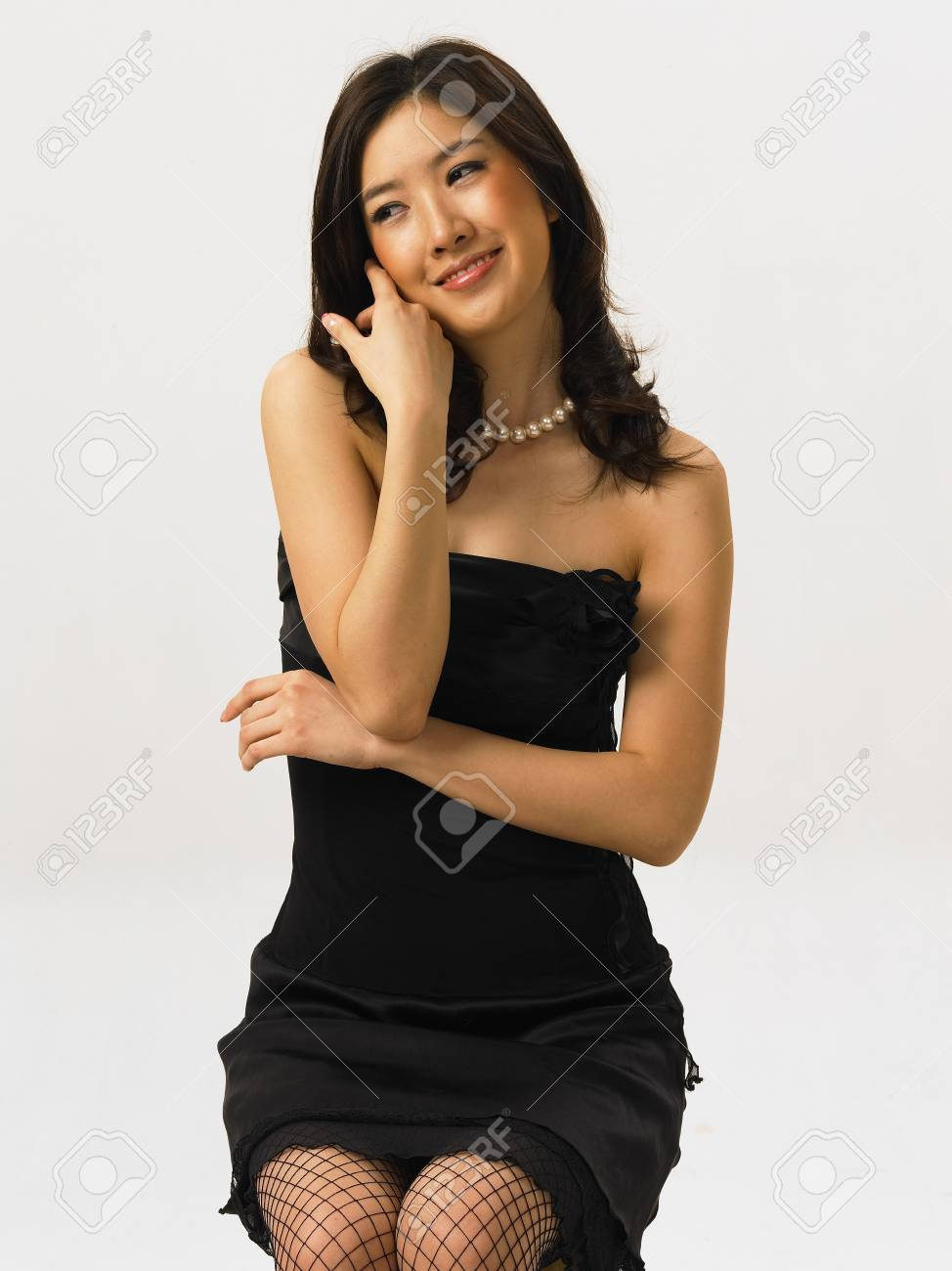 asian woman fashion model posing in a studio as wearing black stock photo picture and royalty free image image 85629480 asian woman fashion model posing in a studio as wearing black