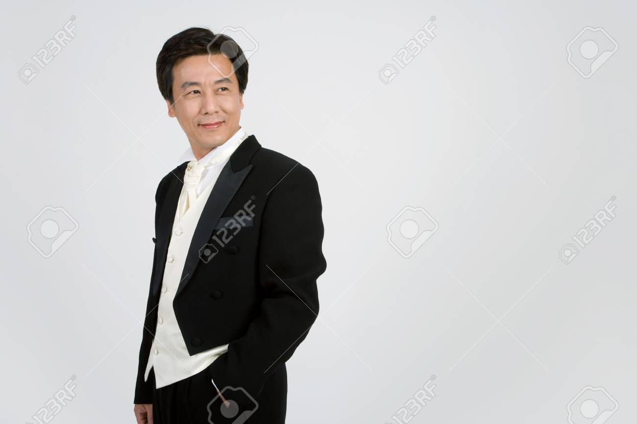 Mid-aged Asian man posing in a studio as wearing wedding tuxedo - 85839117