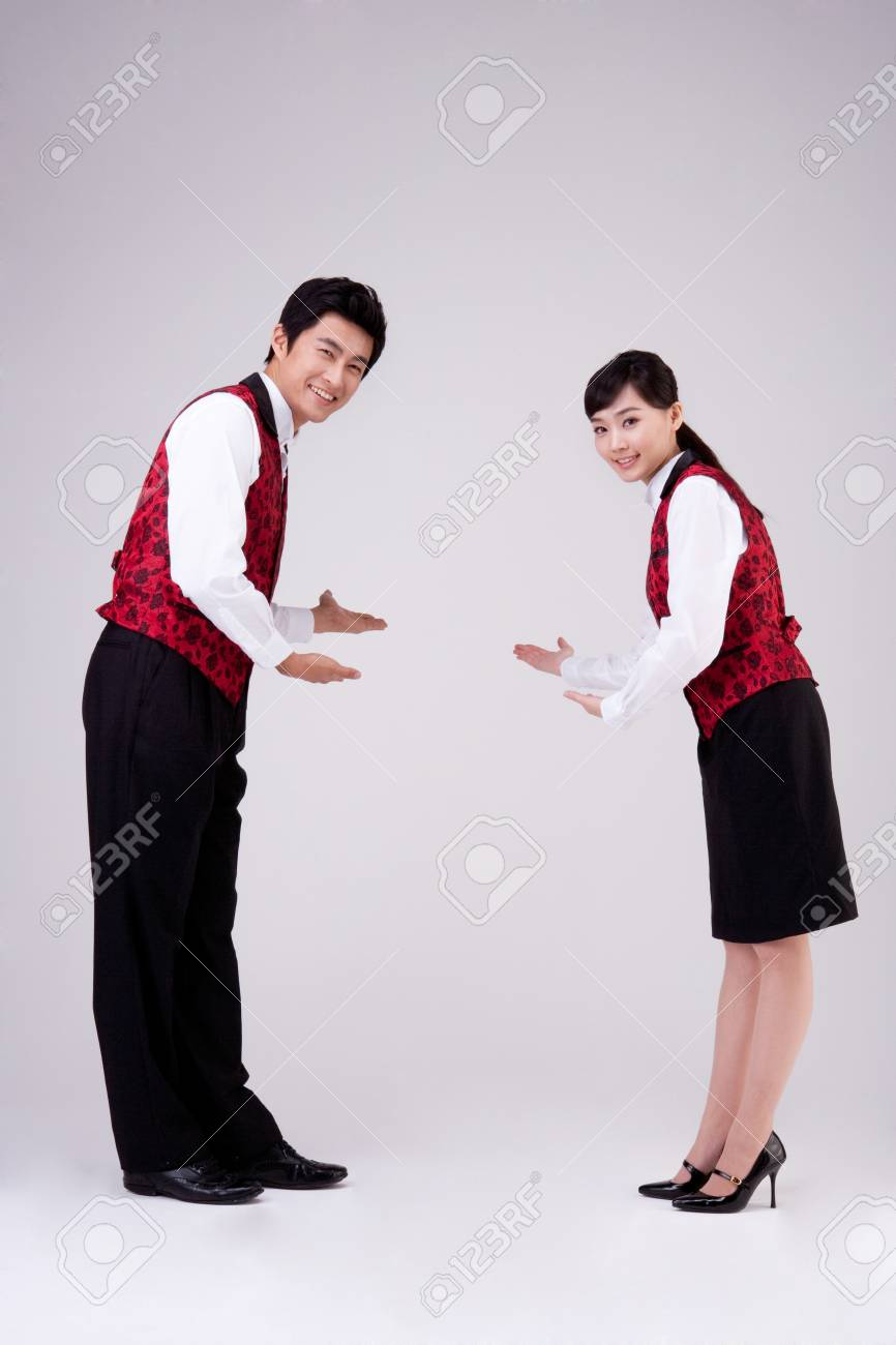 asian restaurant waiter and waitress welcome pose isolated on