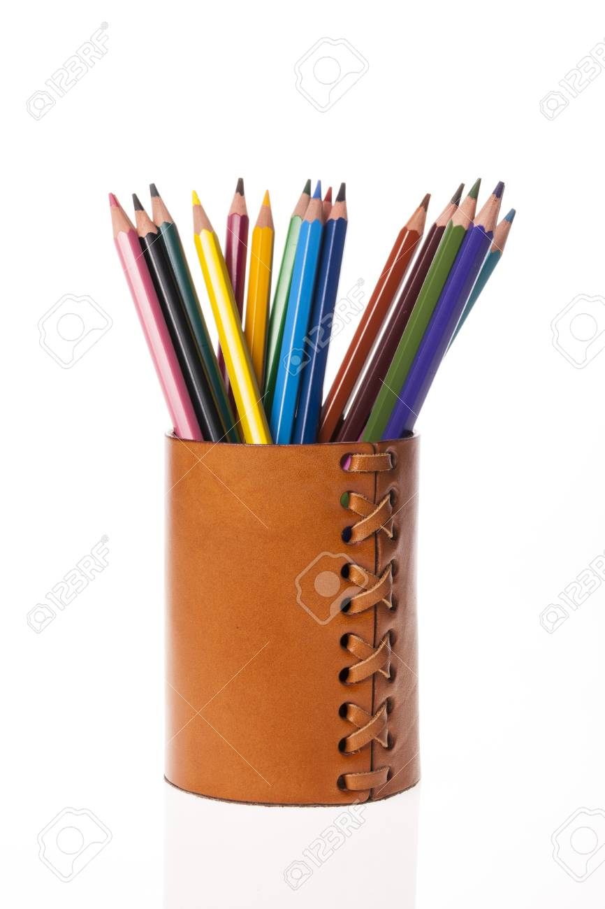 Colored pencils in a brown leather pen case isolated on white background - 93282854