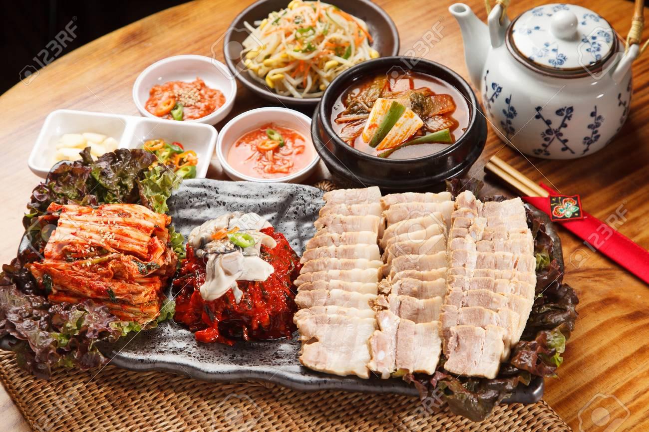 Bossam, a Korean cuisine, boiled pork, cabbage kimchi, radish kimchi - 111935631