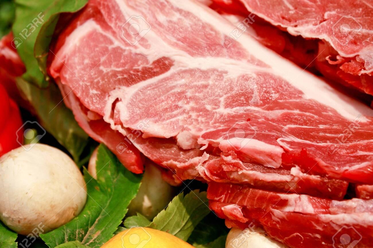 raw pork meat on vegetables - 123866465