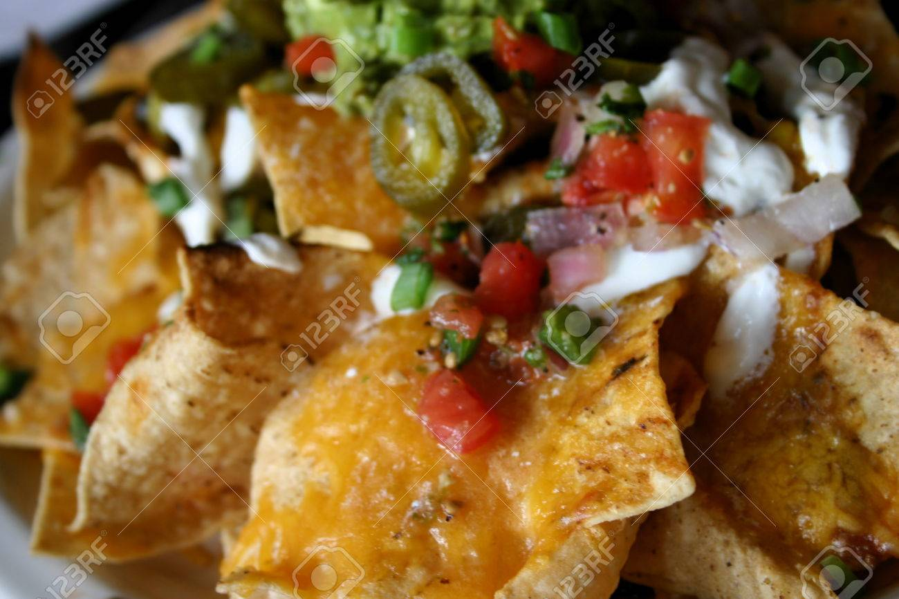 Detail of Deluxe serving of Nachos Grande in Mexican Restaurant Stock Photo - 1665161