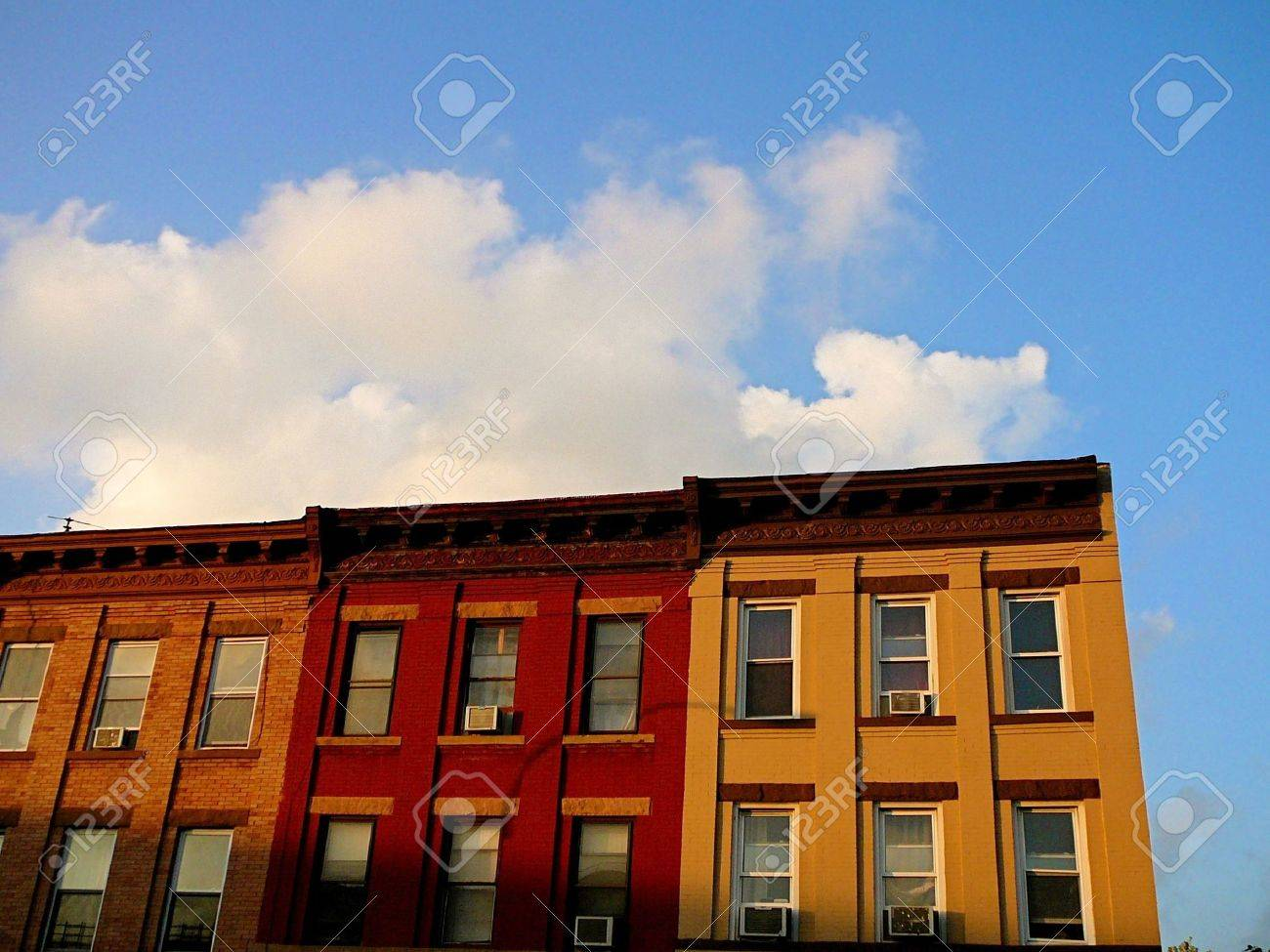 Colorful Row Of Apartment Buildings On Block In Brooklyn New