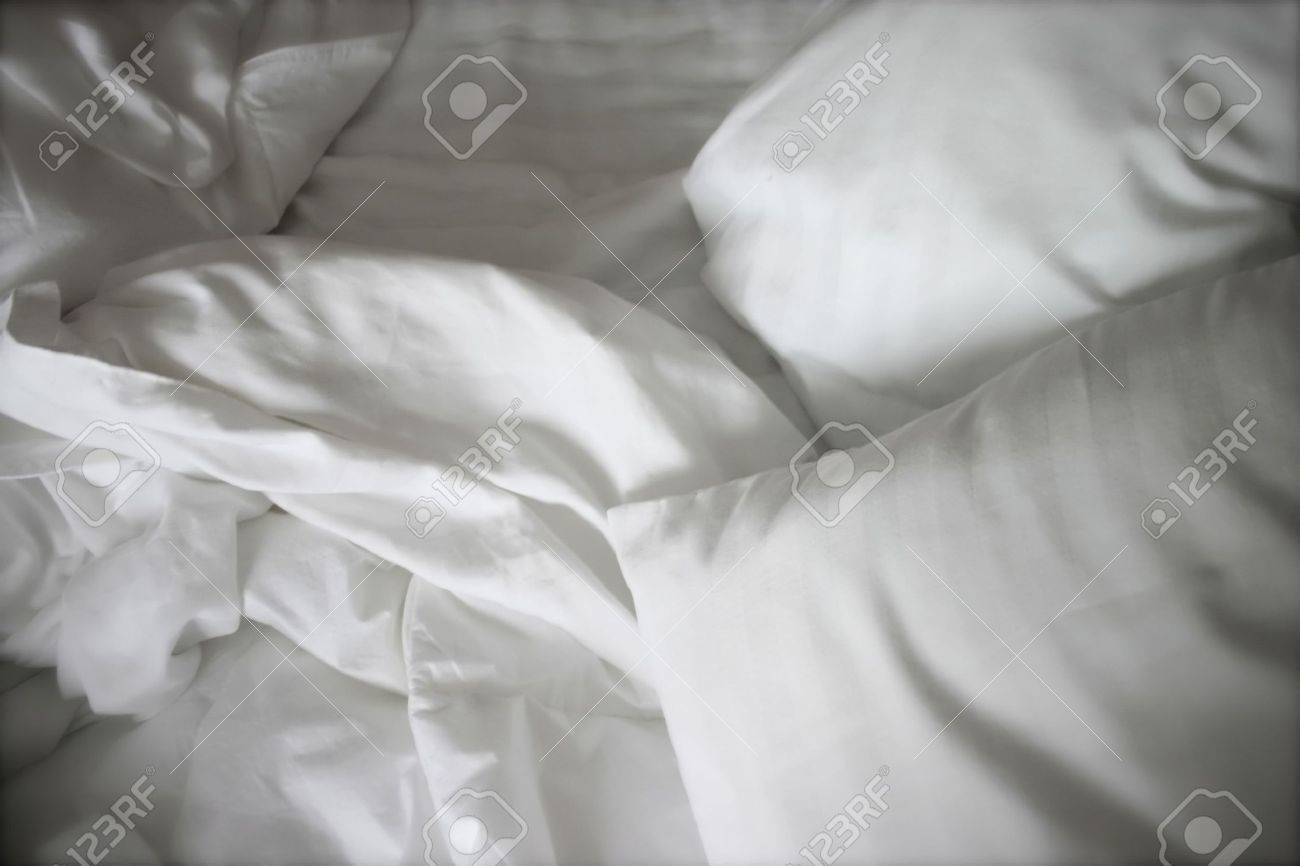 Rumpled bed sheet - Crumpled White Bed Sheets Stock Photo 1978233