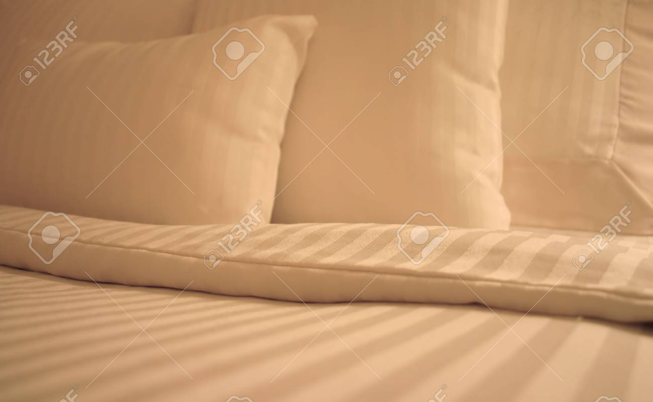 Detail of bed with set of crisp striped sheets and pillows Stock Photo - 2252601