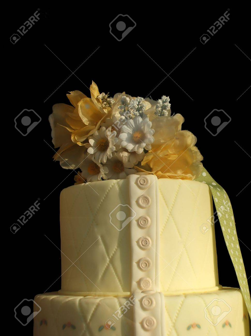 Elaborate Pastel Yellow Floral Cake Isolated Over Black Background Stock Photo - 2685420