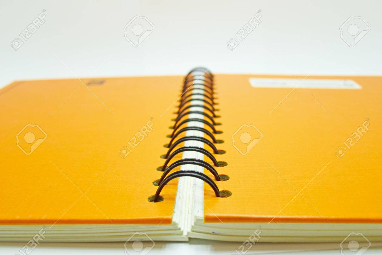 close up notebook spine from back side with black and orange stock