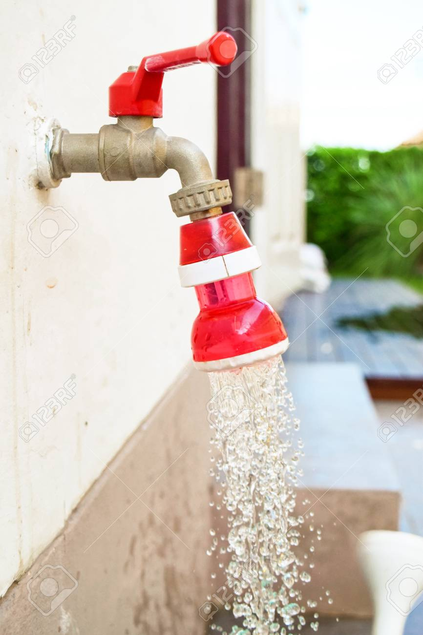 Close Up Red Faucet On Wall Draining Water, Leak Water. Stock Photo ...