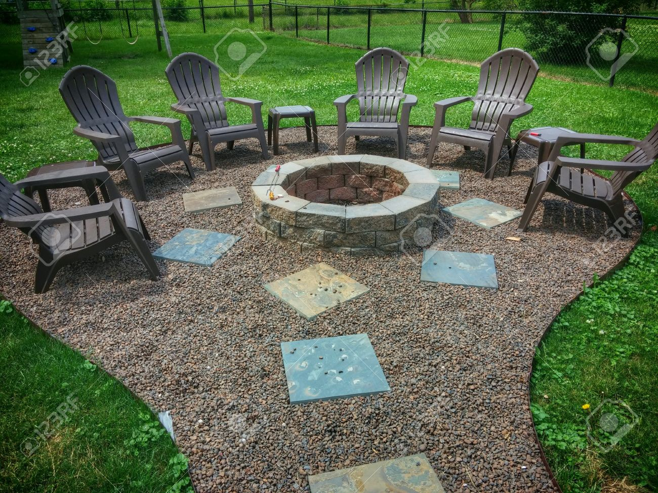 backyard fire pit with various geometric shapes stock photo