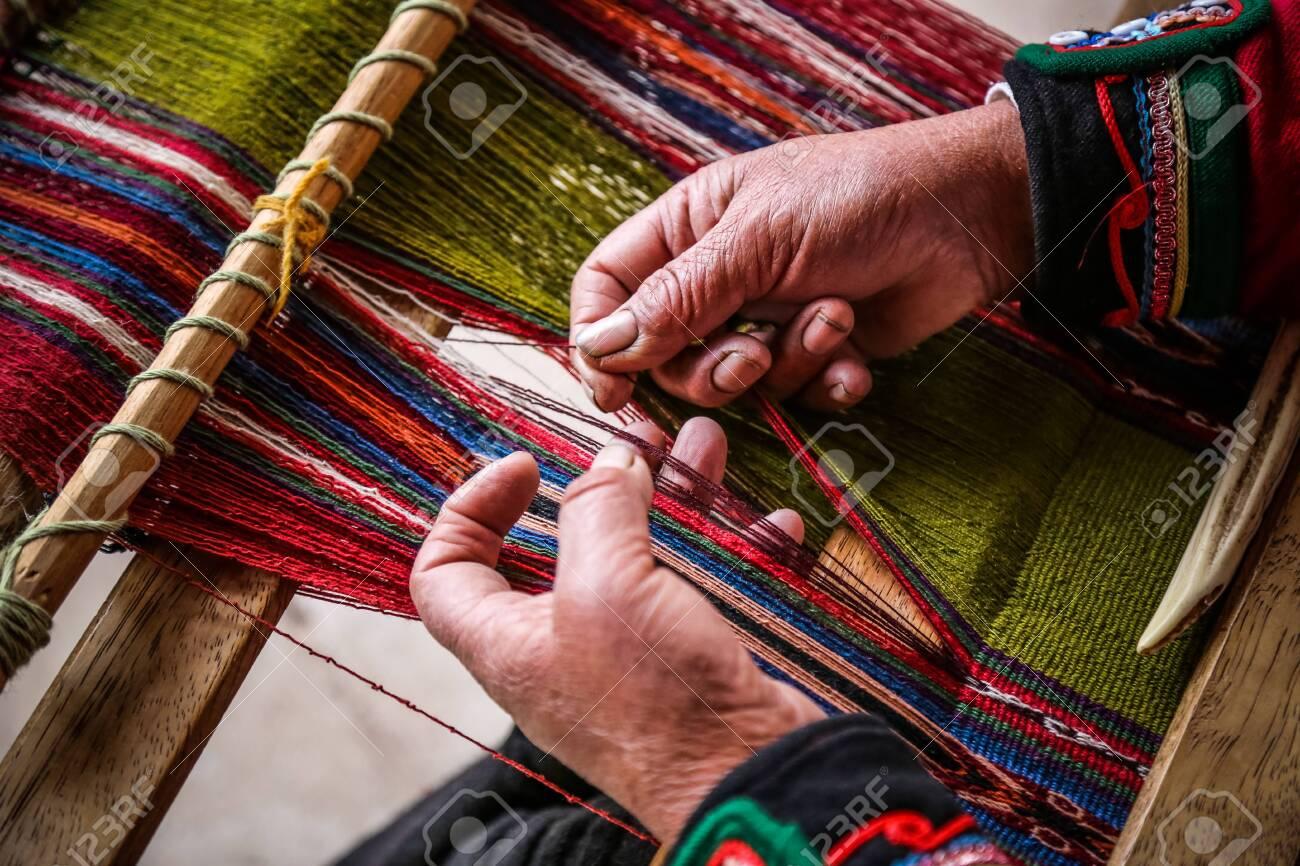 Weaving woman, hand-made colorful materials. Chinchero, Peru. - 124275247