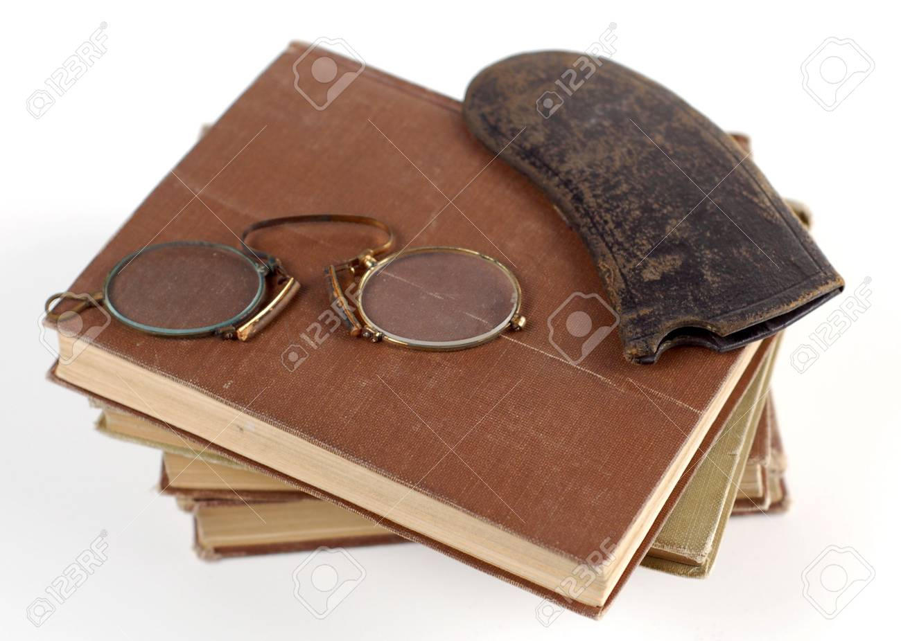 Old glasses sit on a stack of classics. Stock Photo - 965636