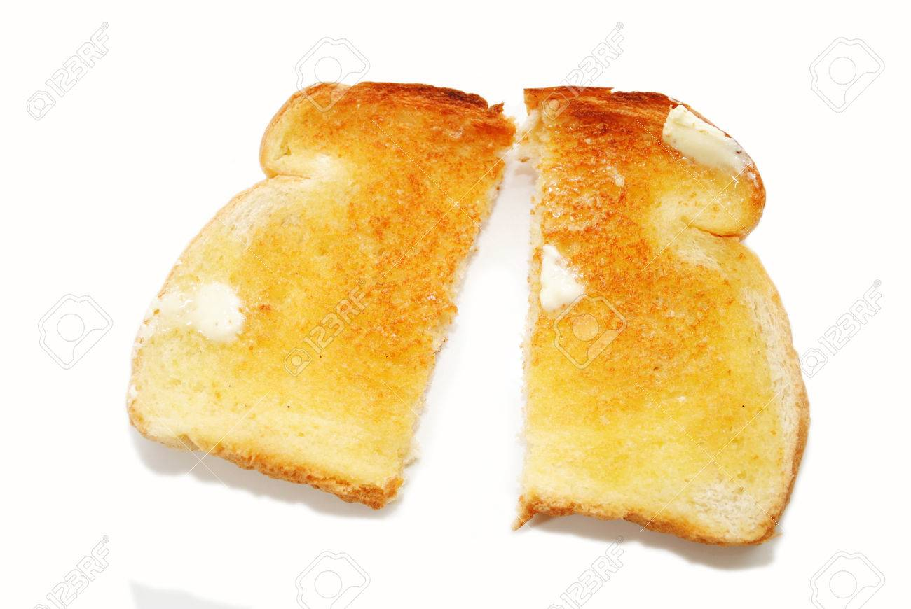 a slice of buttered toast cut in half stock photo picture and