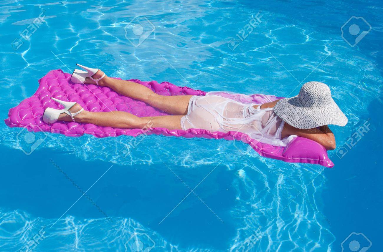 High Float Woman Wearing High Heels Floating On A Pink Float Stock Photo
