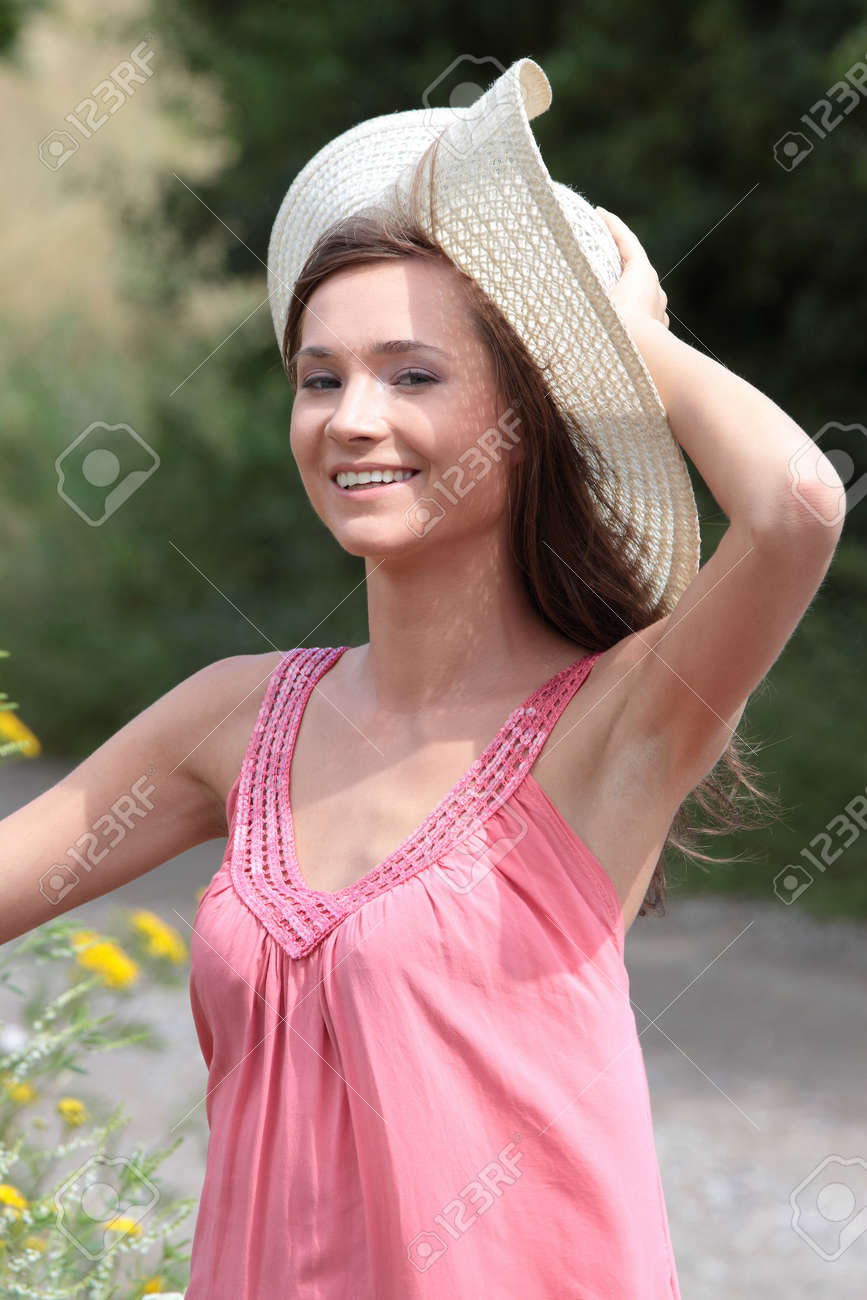 a beautiful girl in big summer hat in the country Stock Photo - 5361941
