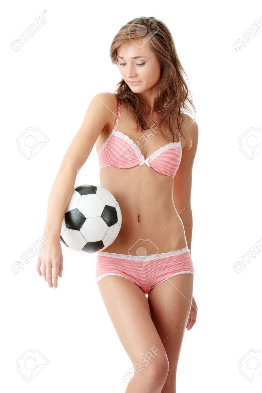 Fashion young woman with a football ball isolated over a white background Stock Photo - 5361345
