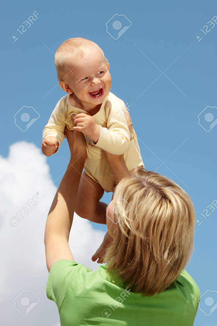 Mother with baby under blue clear sky Stock Photo - 5443744