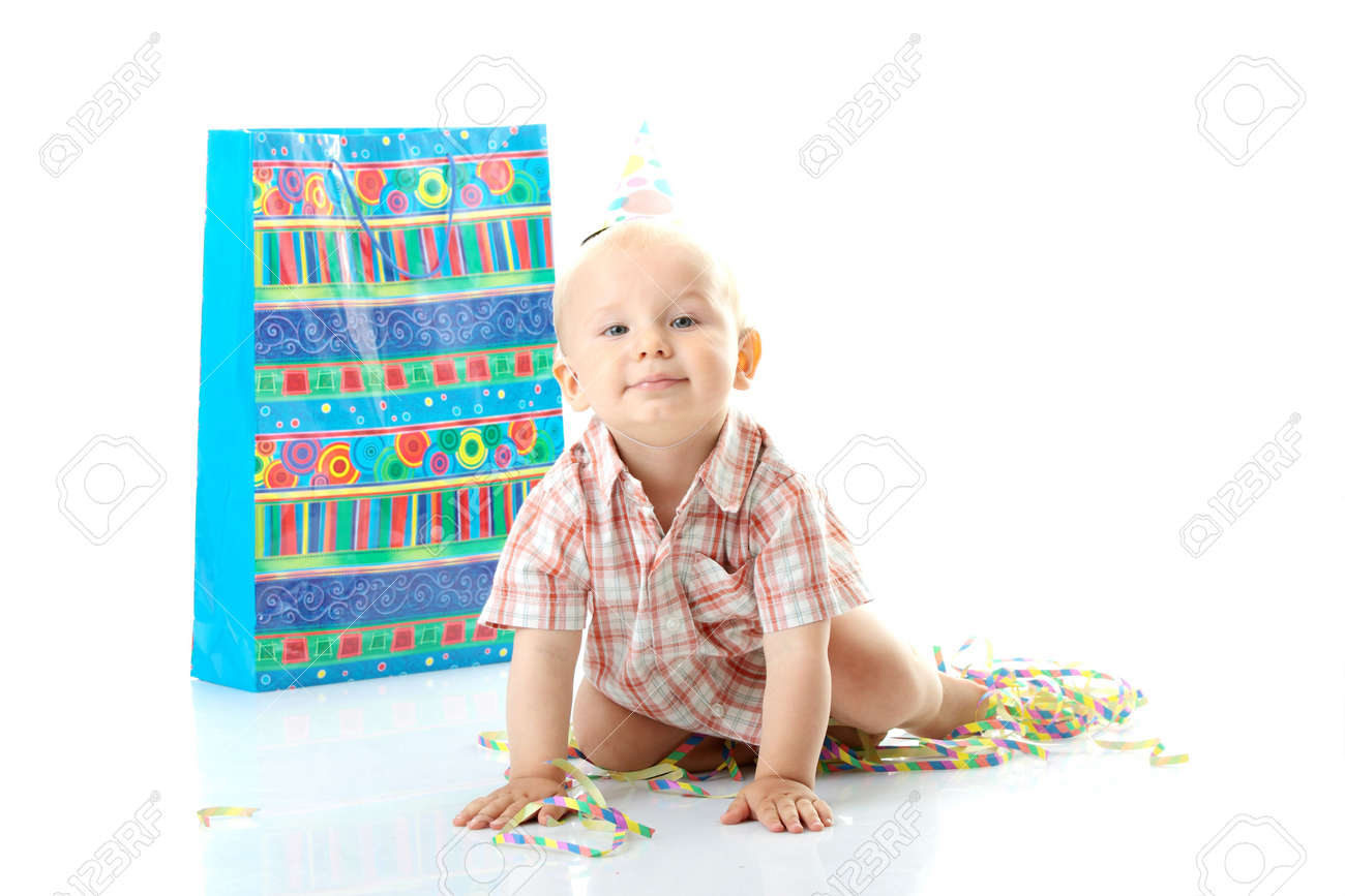 Child boy in birthday hat over white Stock Photo - 5929902