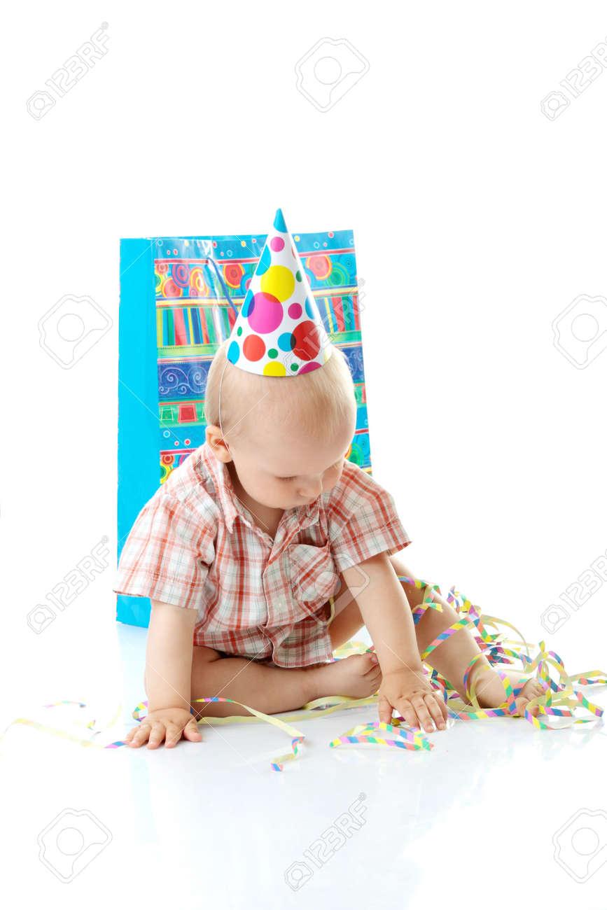 Child boy in birthday hat over white Stock Photo - 5362279