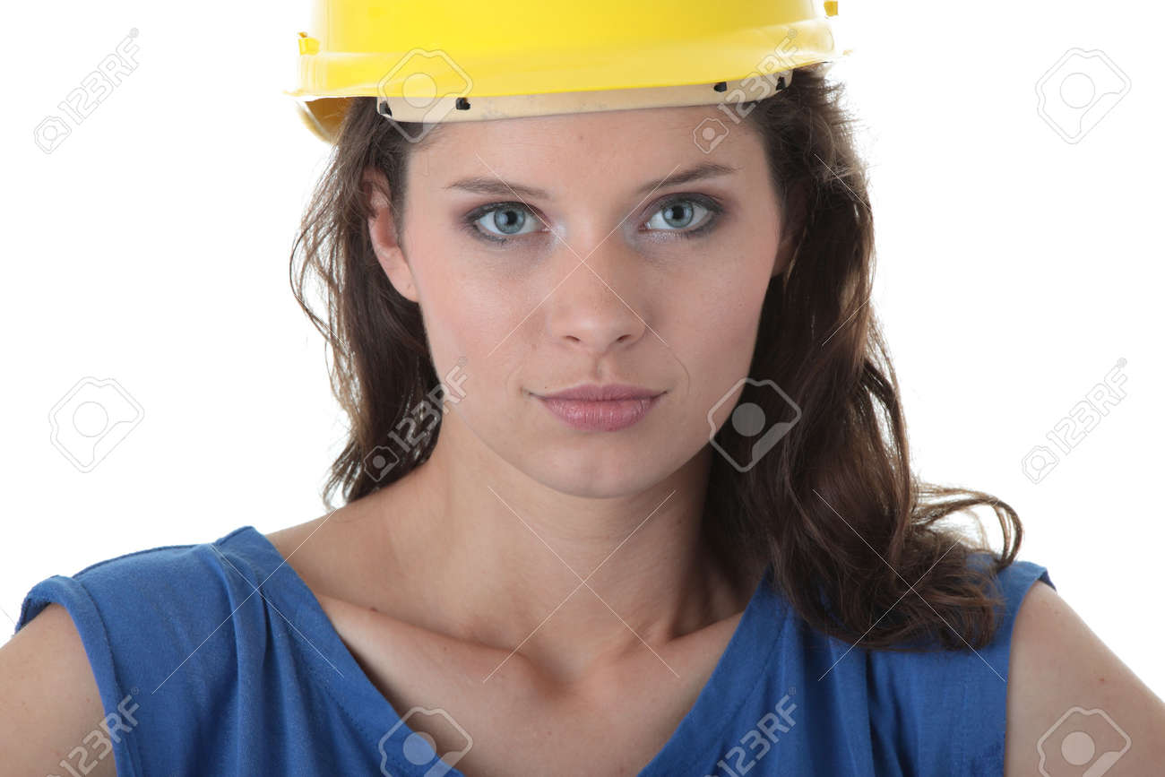 Young female architect or builder wearing a yellow hart hat on a construction site Stock Photo - 5433793
