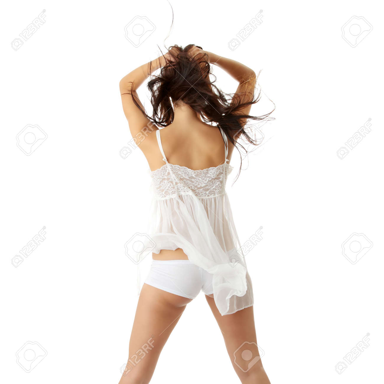 Bautiful young caucasian woman in white sexy lingerie with wind in her hairs isolated on white background Stock Photo - 5757865