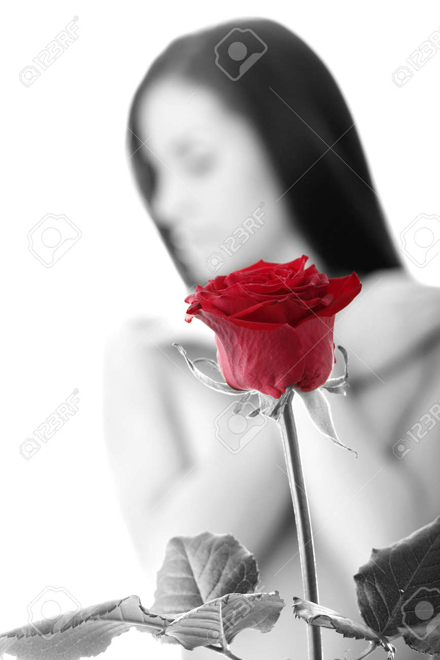 Beautiful red rose against young nude caucasian woman in background Stock Photo - 5978329