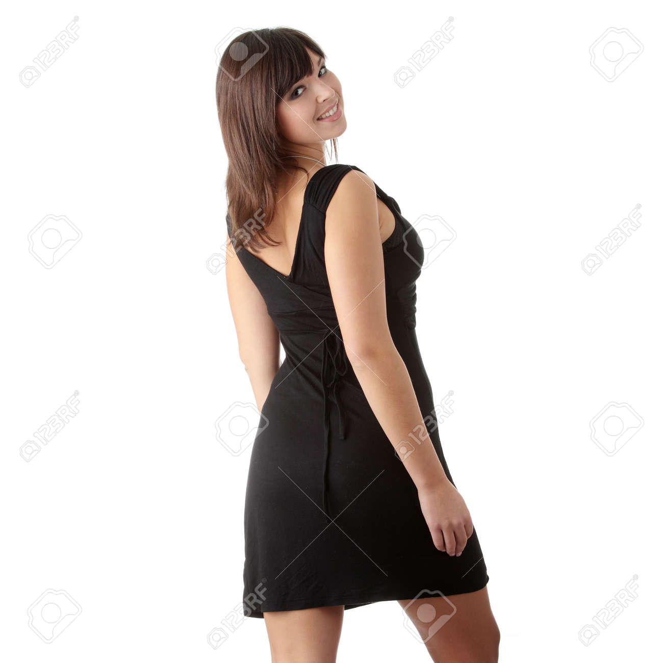922ae7ecf63d5a Mooie jonge vrouw in zwarte jurk geïsoleerd op wit Stockfoto - 24535674