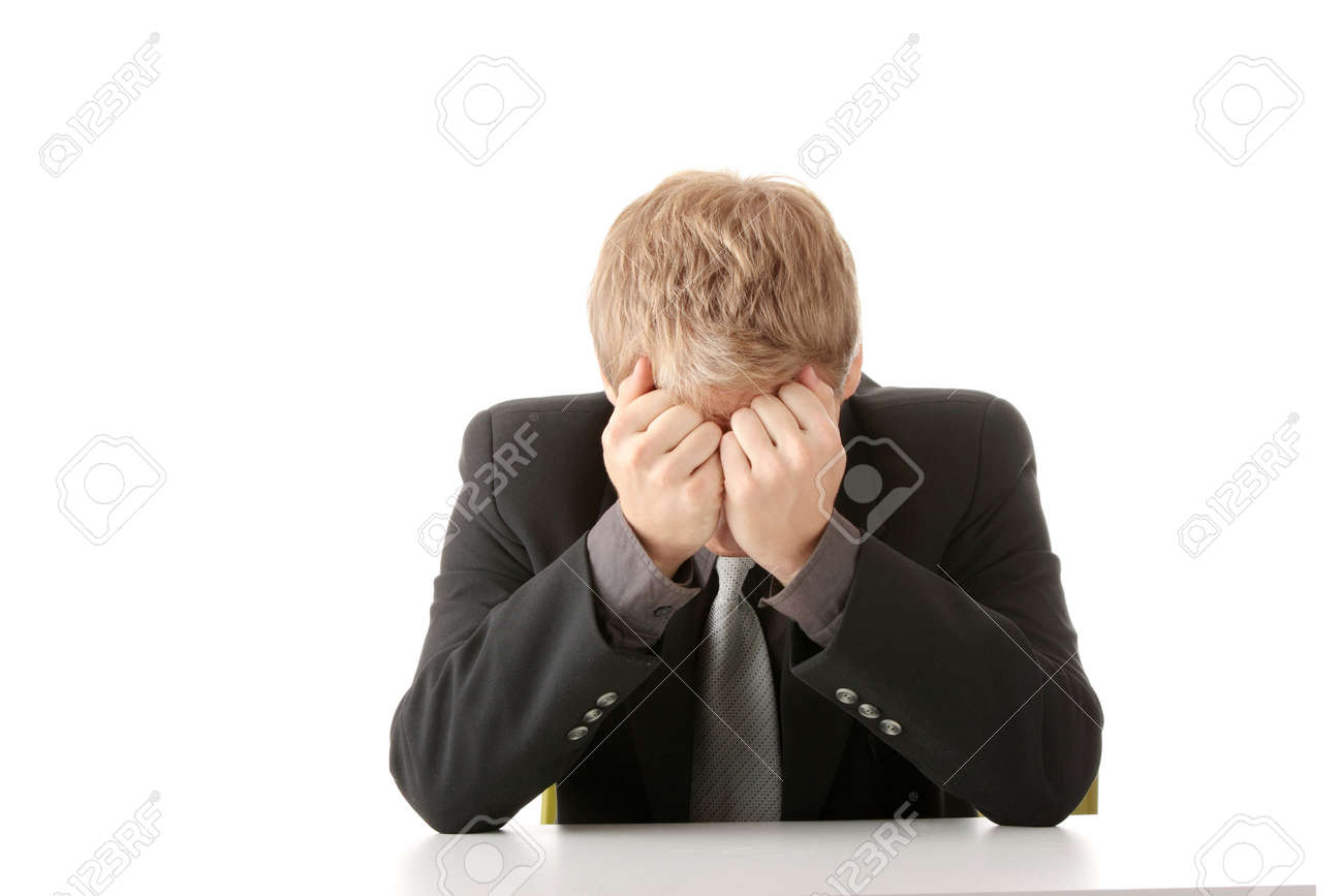 Businessman in depression with hand on forehead, isolated over white Stock Photo - 6019411