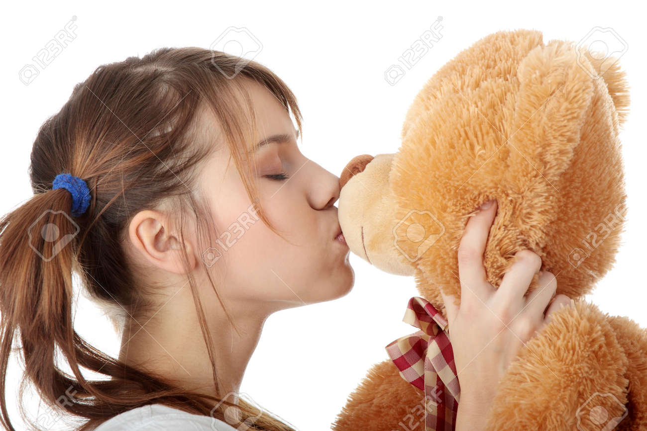Young beautiful teen woman in long shirt with her teddy bear, isolated on white background Stock Photo - 6039874