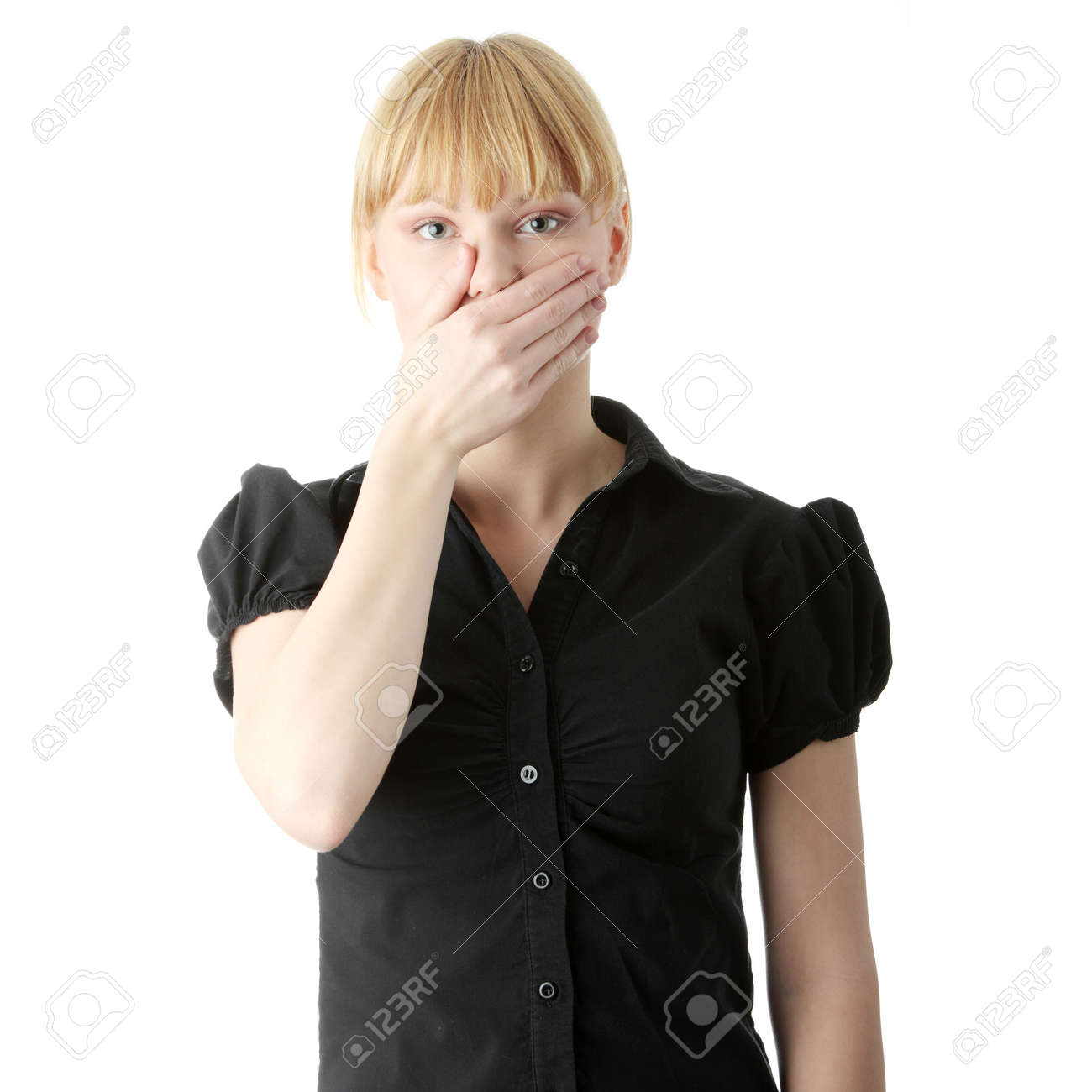 Young woman covering her mouth with hand, isolated on white background Stock Photo - 6175177