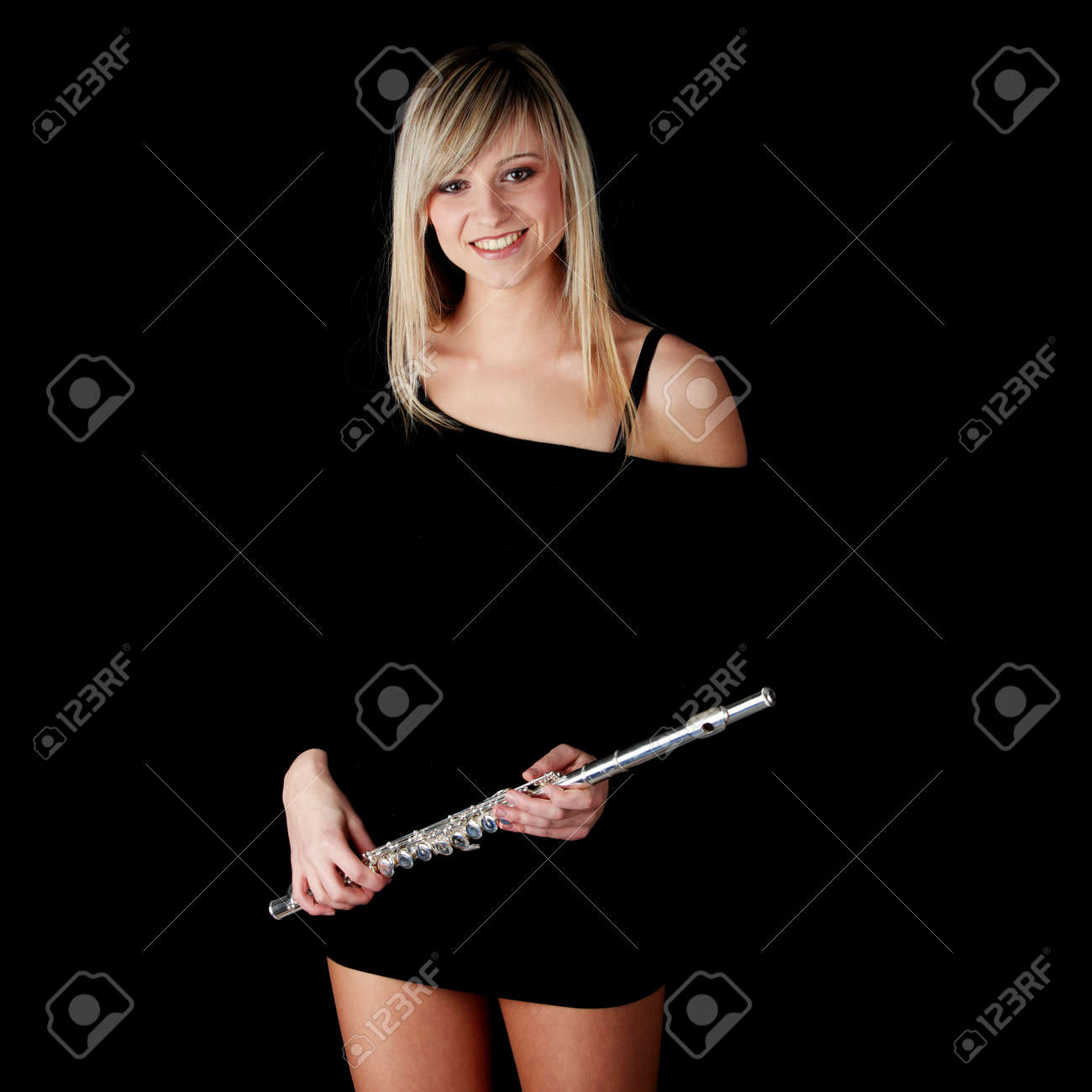 Portrait of a woman playing transverse flute, isolated on black Stock Photo - 6191835