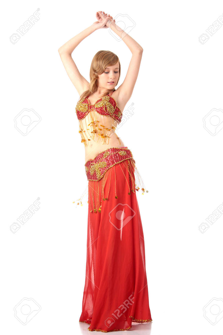 eb946cbef3d36 Stock Photo - Teen girl in belly dancer costume dancing, isolated on white  background