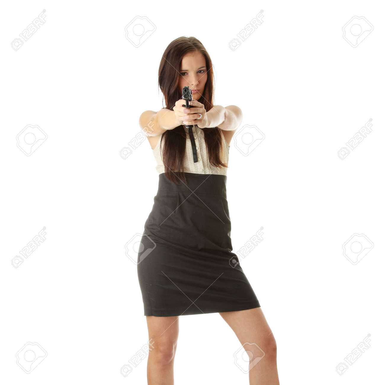 Young woman with hand gun isolated Stock Photo - 6300234