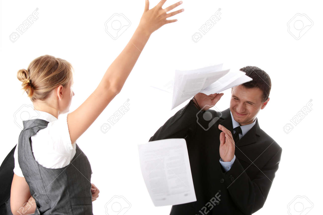 Woman throwing papers on man - office argue concept Stock Photo - 6302297